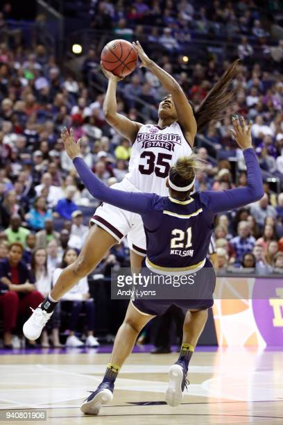 Victoria Vivians of the Mississippi State Lady Bulldogs attempts a shot against Kristina Nelson of the Notre Dame Fighting Irish during the first...