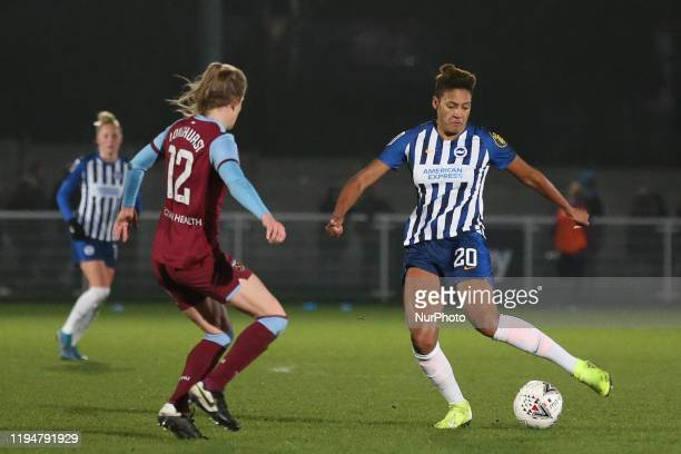 Victoria Williams of Brighton and Hove Albion Women passing the ball past Kate Longhurst of West Ham United Women during the Barclays FA Women's...
