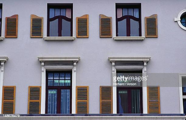 Victorian building facades featuring windows and shutters