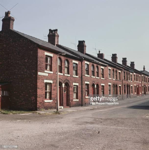 Victorian era two storey terraced housing in Winterdyne Street in the Harpurhey suburb of north east Manchester, England circa 1965.