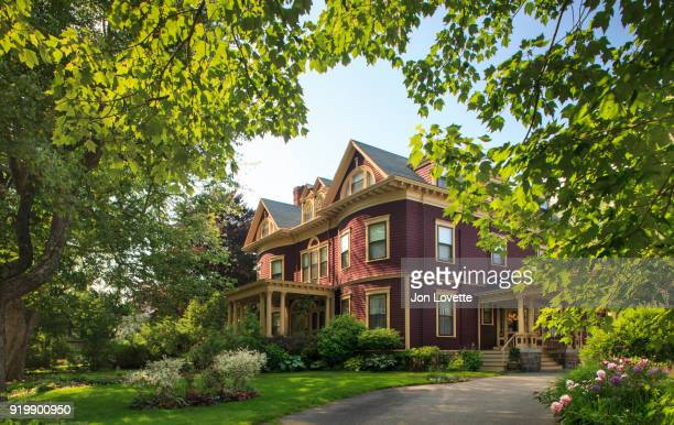 victorian home surrounded by gardens - victorian stock pictures, royalty-free photos & images