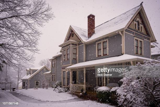 victorian house during snowstorm. - victorian style stock pictures, royalty-free photos & images