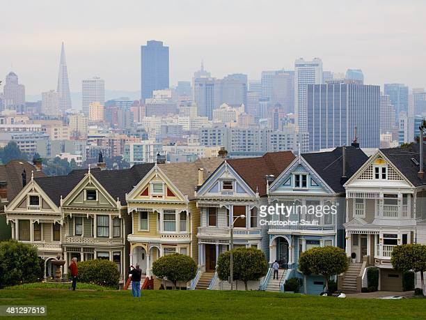 Victorian houses and San Francisco on a hazy day from Alamo Square.
