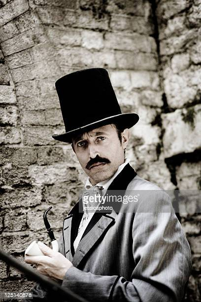 victorian man holding pipe in hand - top hat stock pictures, royalty-free photos & images