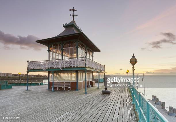 a victorian pavilion on the restored clevedon pier, seen at dusk, clevedon, north somerset, england, united kingdom, europe - clevedon pier stock pictures, royalty-free photos & images