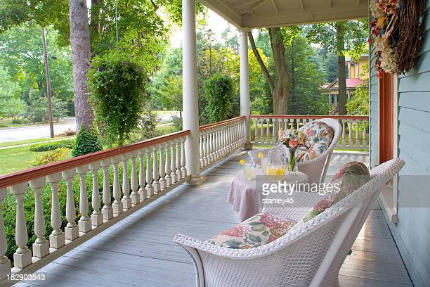 Victorian porch with vintage armchairs in summertime
