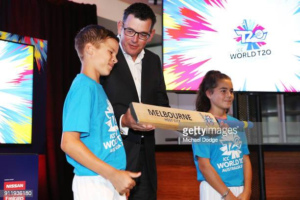 Victorian Premier Daniel Andrews acccepts a cricket bat during the ICC World T20 media opportunity at on January 30 2018 in Melbourne Australia
