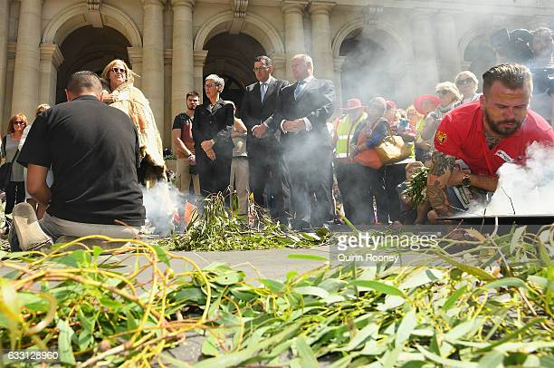 Victorian Premier Daniel Andrews and Lord Mayor of Melbourne Robert Doyle attend a smoking ceremony before the floral memorial on Bourke Street is...