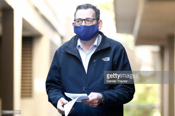 Victorian Premier Daniel Andrews wears a face mask as he walks in to the daily briefing on July 19, 2020 in Melbourne, Australia. Metropolitan...