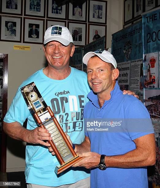 Victorian Premier Ted Baillieu and Federal Opposition Leader Tony Abbott fight over the Open Mens trophy during the 2012 Pier to Pub on January 7...