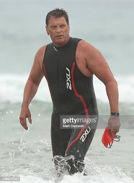 Victorian Premier Ted Baillieu walks out of the water during the 2012 Pier to Pub on January 7 2012 in Lorne Australia