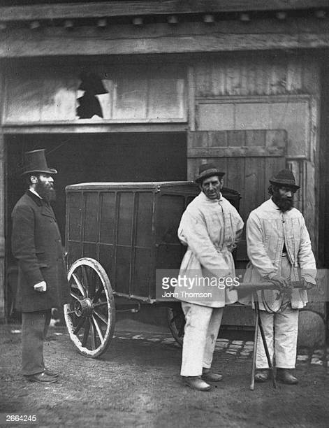 Victorian public disinfectors sanitize the streets after an outbreak of smallpox Original Artwork From 'Street Life In London' by John Thomson and...