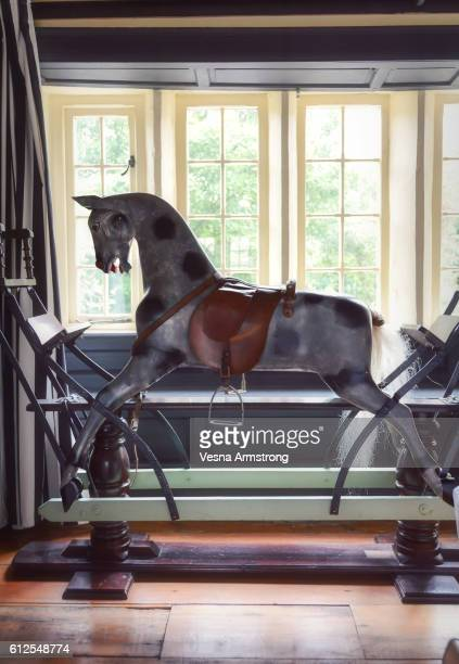 Victorian Rocking Horse in Front of Window