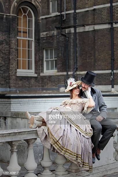 Victorian romantic couple on balustrade