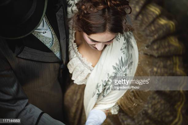 victorian romantic couple whirls while dancing together. - period costume stock pictures, royalty-free photos & images