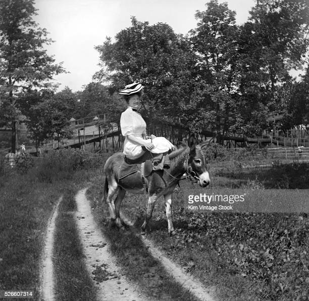 Victorian woman rides a donkey ca 1897