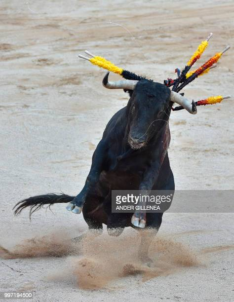 A Victoriano del Rio fighting bull jumps during a bullfight of the San Fermin festival in Pamplona northern Spain on July 12 2018 Each day at 8am...