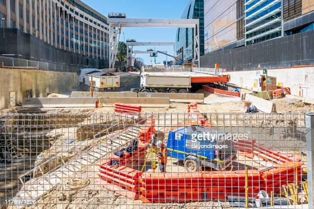 victoria's big build: metro tunnel construction site for underground parkville station with truck - generator stock pictures, royalty-free photos & images