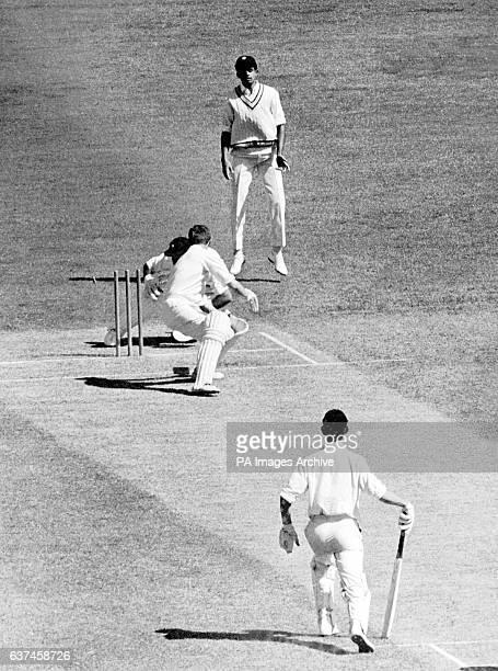 Victoria's Bob Cowper is stumped by India wicketkeeper Farokh Engineer as India's Venkataraman Subramanya and Victoria's Ian Redpath look on
