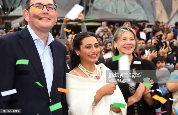 Victoria's Premier Daniel Andrews and Indian actress Rani Mukerji are showered with confetti after unfurling the Indian flag in Federation Square at...