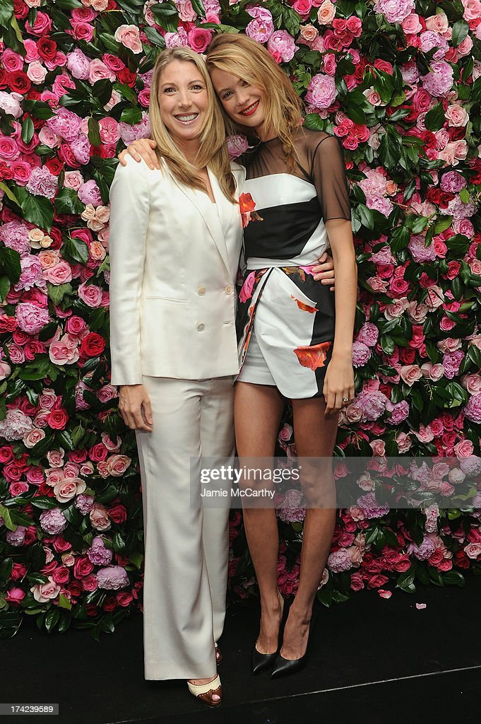 Victoria's Secret Angel Behati Prinsloo (R) and President of Victoria's Secret Beauty, Susie Coulter pose together at the Victoria by Victoria's Secret Fragrance launch event at 620 Loft & Garden on July 18, 2013 in New York City.
