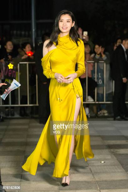 Victoria's Secret Angel Ming Xi arrives at the red carpet of the MercedesBenz 'Backstage Secrets' By Russell James Book Launch Shanghai Exhibition...