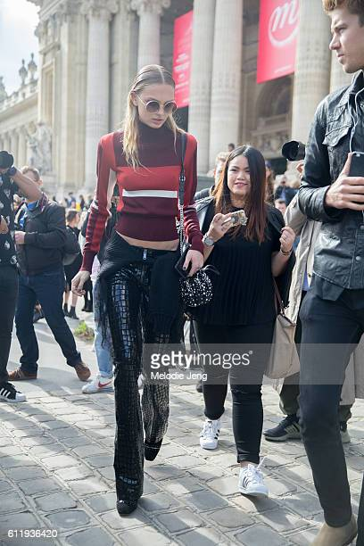 Victoria's Secret Angel model Romee Strijd wears crocodile leather trousers outside the Mugler show at Grand Palais on October 1 2016 in Paris France