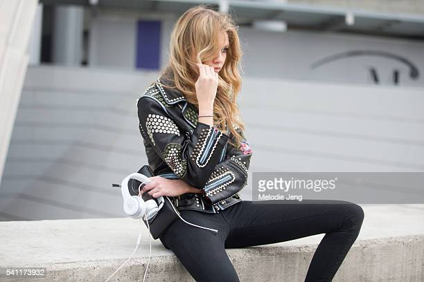 Victoria's Secret Angel Stella Maxwell wears a gold studded black leather jacket after the Versace show during the Milan Men's Fashion Week...