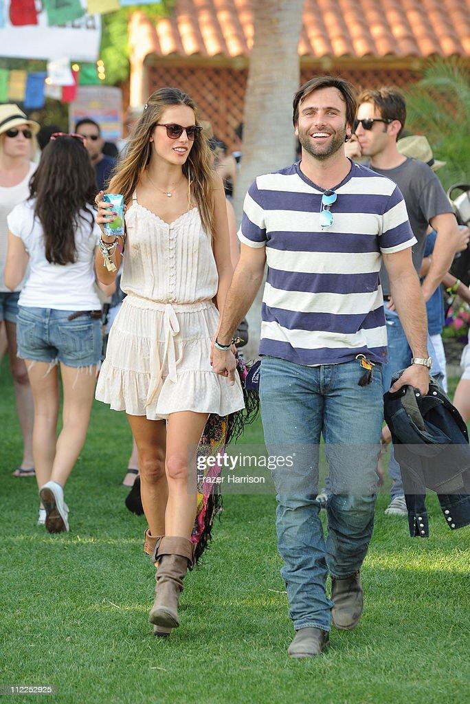 Victoria's Secret model Alessandra Ambrosio (L) and Jamie Mazur kept cool at the Coachella Valley Music Festival with O.N.E. Coconut Water on April 15, 2011 in Indio, California.