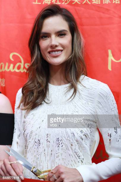 Victoria's Secret model Alessandra Ambrosio attends the unveiling ceremony of her wax figure at Shanghai Madame Tussauds on March 6 2017 in Shanghai...