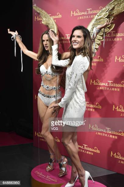 Victoria's Secret model Alessandra Ambrosio poses with her wax figure at Shanghai Madame Tussauds on March 6 2017 in Shanghai China