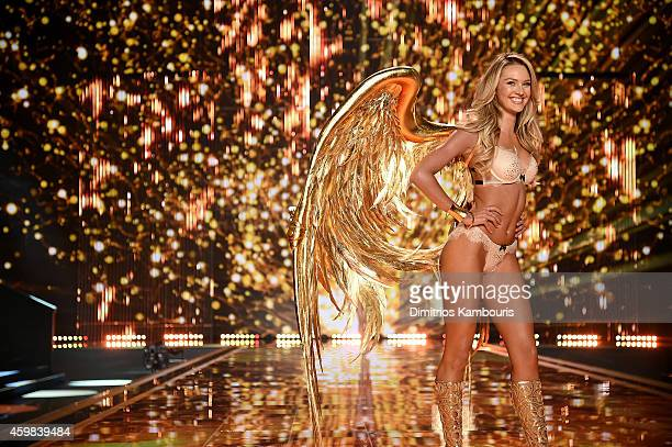 Victoria's Secret model Candice Swanepoel walks the runway during the 2014 Victoria's Secret Fashion Show at Earl's Court exhibition centre on...