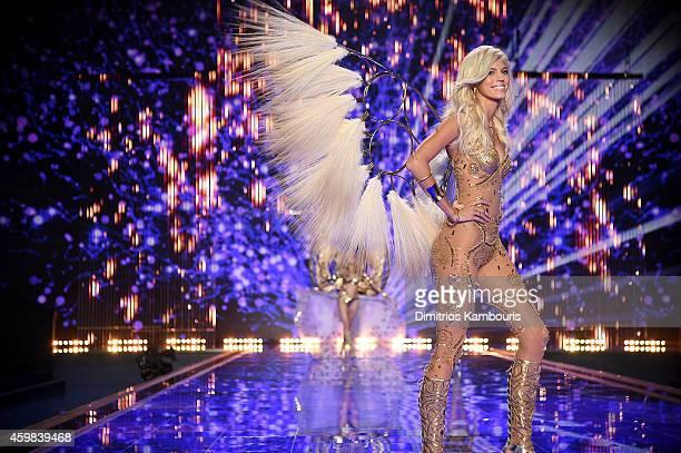 Victoria's Secret model Devon Windsor walks the runway during the 2014 Victoria's Secret Fashion Show at Earl's Court exhibition centre on December 2...