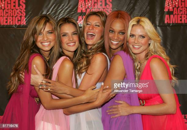 Victoria's Secret models Adriana Lima Alessandra Ambrosio Gisele Bundchen Tyra Banks Heidi Klum pose during their Angels Across America Tour stop in...