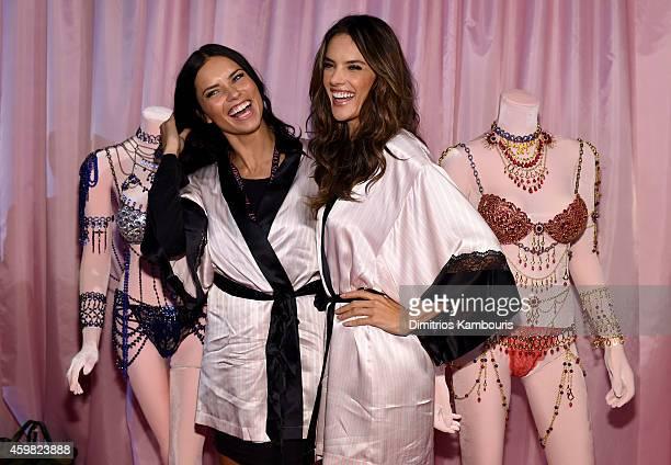Victoria's Secret models Adriana Lima and Alessandra Ambrosio pose backstage prior the 2014 Victoria's Secret Fashion Show on December 2 2014 in...