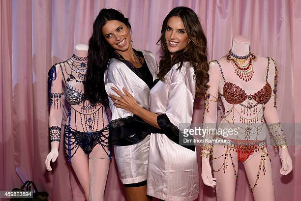 Victoria's Secret models Adriana Lima and Alessandra Ambrosio pose backstage prior the 2014 Victoria's Secret Fashion Show on December 2 2014 in...