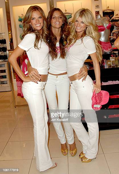 Victoria's Secret models Alessandra Ambrosio Izabel Goulart and Marisa Miller pose at the Victoria's Secret Angels Share Their Favorite Holiday Gift...