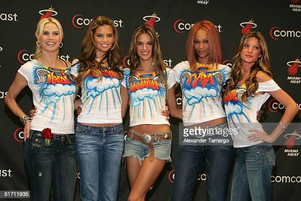 Victoria's Secret models Heidi Klum Adriana Lima Alessandra Ambrosio Tyra Banks and Gisele Bundchen pose backstage during the Miami Heat vs...