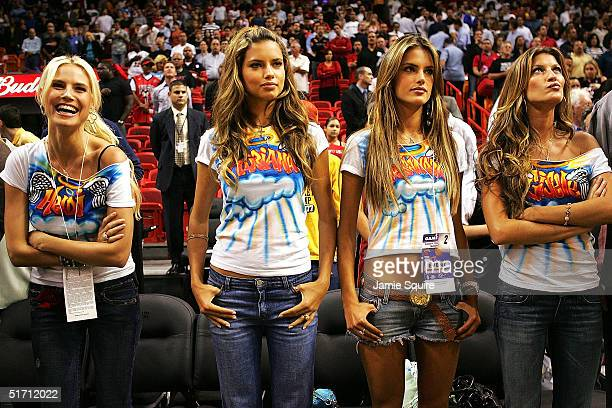 Victoria's Secret Models Heidi Klum Adriana Lima Alessandra Ambrosio and Gisele Bundchen watch the game between the Miami Heat and the Washington...
