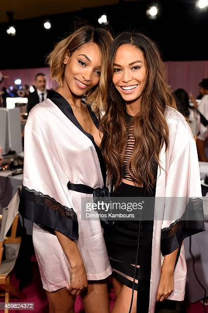 Victoria's Secret models Jourdan Dunn and Joan Smalls are seen backstage prior the 2014 Victoria's Secret Fashion Show on December 2, 2014 in London,...