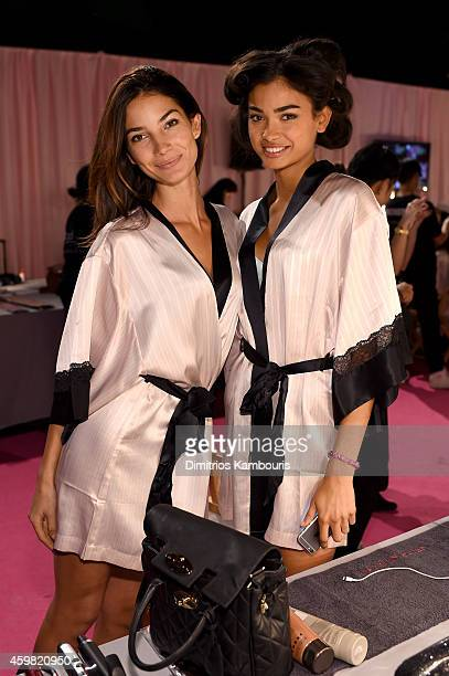 Victoria's Secret models Lily Aldridge and Kelly Gale are seen backstage prior the 2014 Victoria's Secret Fashion Show on December 2 2014 in London...