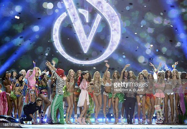 Victoria's Secret models with Justin Bieber Rihanna and Bruno Mars during the 2012 Victoria's Secret Fashion Show at the Lexington Avenue Armory on...