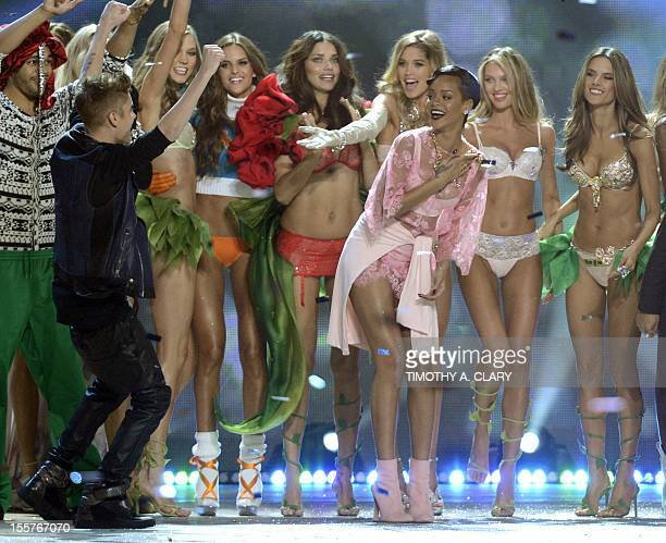 Victoria's Secret models with Rihanna and Justin Bieber during the 2012 Victoria's Secret Fashion Show at the Lexington Avenue Armory on November 7...