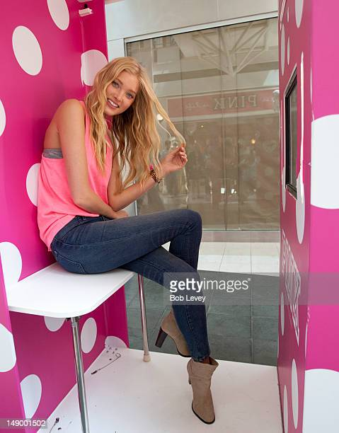 Victoria's Secret PINK model Elsa Hosk has her photo taken in the PINK Photo Booth as helps unveil its first store at The Woodlands Mall on July 21...