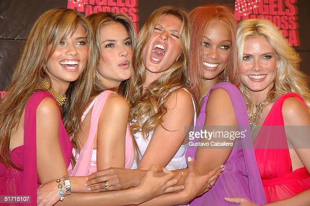 Victoria's Secret Supemodels Adriana Lima Alessandra Ambrosio Gisele Bundchen Tyra Banks and Heidi Klum stand together as they participate in the...