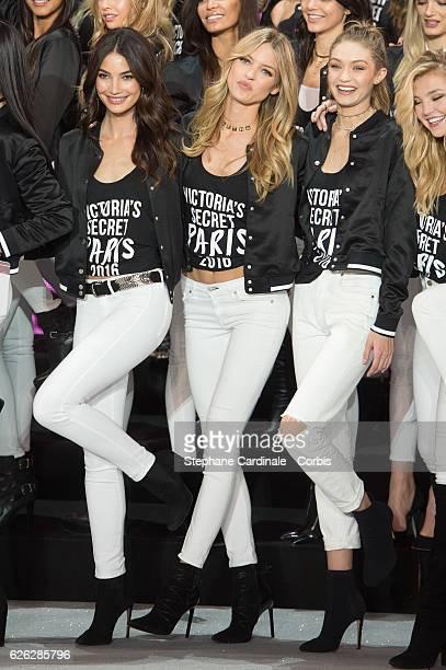 'Victoria's Secret' supermodel Lily Aldridge Martha Hunt and Gigi Hadid pose during a photocall to mark the countdown to the '2016 Victoria's Secret'...