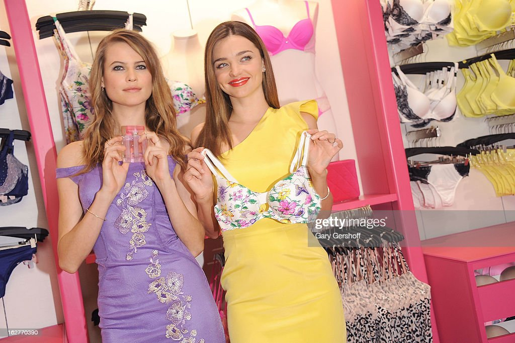 Victoria's Secret Supermodels Behati Prinsloo (L) and Miranda Kerr attend the Fabulous Collection Launch at Victoria's Secret Herald Square on February 26, 2013 in New York City.