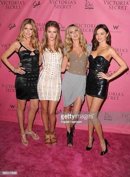 Victoria's Secret Supermodels Doutzen Kroes Rosie HuntingtonWhiteley Candice Swanepoel Miranda Kerr pose at the reveal of Victoria's Secret...