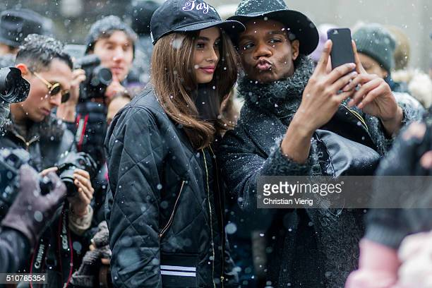 Victoria'u2019s Secret model Taylor Marie Hill taking selfies with fans wearing a black bomber jacket and a Taylor cap seen outside Jeremy Scott...
