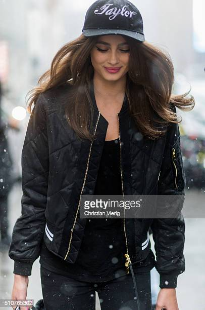 Victoria'u2019s Secret model Taylor Marie Hill wearing a black bomber jacket and a Taylor cap seen outside Jeremy Scott during New York Fashion Week...